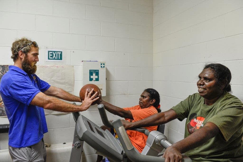 Physiotherapist and owner of Active Performance, Nick Kenny, works with two indigenous healthcare patients in a community health clinics